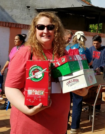 Betsy Burnett with shoebox gifts in Paraguay