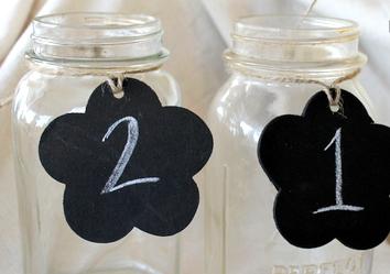 http://www.allfreeholidaycrafts.com/Wedding-Ideas/So-Easy-Chalkboard-Table-Numbers